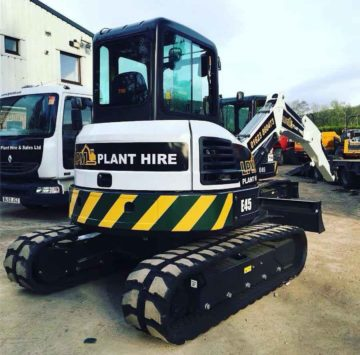 Tracked mini digger with branding and contact details